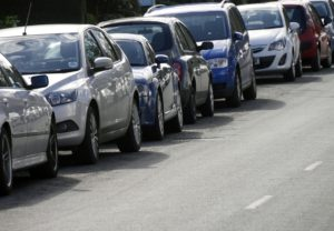 Long row of cars parked on city centre road